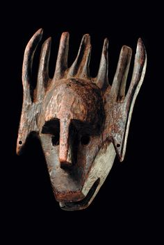 Africa | Mask 'ntomo' from the Bamana people of Mali | Wood with dark brown patina