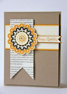handmade card from Ladybug Designs: Quint-Essential Flower Card ... kraft base ... clean and simple ... book paper print on fish tail banner .,,. one large flower ...  like the basic design ... Stampin' Up!
