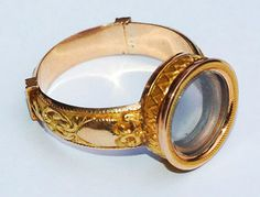 A Gold Ring, French, circa 1820, which pulls open to reveal a so-called Galilean telescope with a combination of a convex or converging lens and a dispersing lens. Designed as 'toys' or amusements for the wealthy, these miniature telescopes were found hidden in fans and perfume bottles as well as in pieces of jewellery. A pendant with a telescope is in the British Museum and a similar ring is in the Koch collection.