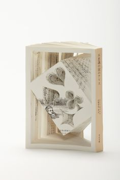 Alice's Adventures in Wonderland by Lewis Carroll In her series Fragments of Story, Tokyo-based art director Tomoko Takeda creates sculptures inspired by classic works of literature using the actua. Famous Novels, Famous Books, Altered Books, Altered Art, Cut And Fold Books, Quentin Blake, Writing Art, Classic Books, Classic Literature