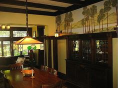 Arts Crafts dining room with wall friezes.