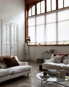 concrete, big windows, white and wood