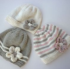 A knitting pattern for a baby hat with flower. This PDF pattern is an easy knit baby pattern. It is really three patterns rather than one!! This hat is sure to get so many compliments when baby is out in the stroller! Instructions are given for a three color stripe version, a ridged stripe #knittingpatternsbaby