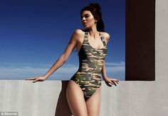 Picturesque: Continuing her leggy display, she slipped into a camouflage one-piece as she posed against the clear-blue sky