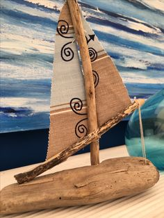 Another of my driftwood creations, with my wife's  screen-printed textiles for sailcloth! (Prints and abstract seascape ©Manisha Harkins)