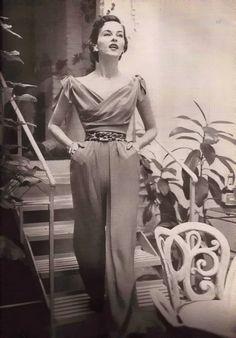 So chic....Vogue June 1950s pant suit jump suit wide legs portrait decline bow shoulders vintage fashion unique design style