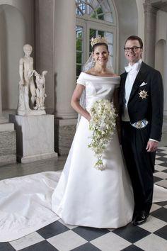 Crown Princess Victoria of Sweden, in a Par Engsheden design, and Prince Daniel at their wedding ceremony in Stockholm, July 2010.