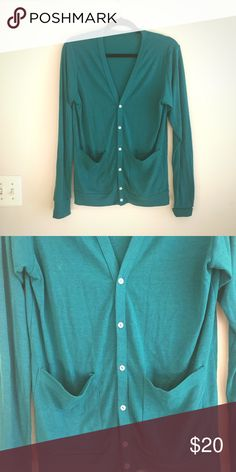 American Apparel Cardigan Green A green American apparel triblend pocket cardigan. Super cute and in GUC, worn and loved but no pulls or major piling. Shape has held up nicely with a slimming silhouette.  The green is a jewel tone jade, which is flattering on most skin tones! Cardigan is a unisex small but fits like a women's medium. Will consider offers :) American Apparel Sweaters Cardigans