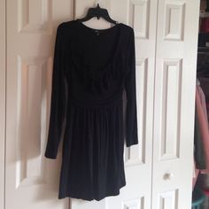 Forever 21 Dress With Ruffle Neckline Gently worn, much loved little black dress. Super cute with a good amount of stretch. Could fit a size Large as well Forever 21 Dresses
