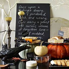 Write a spooky poem on a chalkboard for an easy and inexpensive way to decorate for a Halloween party. See the rest of this Halloween buffet: http://www.bhg.com/halloween/recipes/set-up-a-spooky-halloween-buffet/?socsrc=bhgpin091112halloweenchalkboard