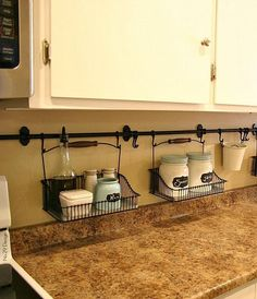 By hanging curtain rods and holders, you're able to eliminate the clutter on your kitchen counter. Easy clean ups! kitchen storage ideas, kitchen organizing ideas, DIY home decor ideas Küchen Design, House Design, Design Ideas, Interior Design, Modern Interior, Diy Interior, Kitchen Interior, Room Interior, Layout Design