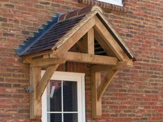 Oak Framed Porches in Oxfordshire, Hampshire, Berkshire and Buckinghamshire Porch Canopy Kit, Door Canopy Kits, Front Door Canopy, Cottage Front Doors, Cottage Porch, Wood Front Doors, Porch Timber, Timber Door, Porch Roof