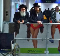 Perfectly Timed Photos ~ jewfish men in front of sign woman's legs