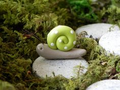 A whimsical handmade miniature snail for your fairy garden, miniature garden, or terrarium. Each one is hand sculpted from polymer clay so no