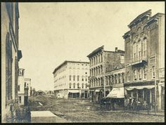 Pearl St. near Monroe in 1872. The Amway Grand Plaza is now located where Sweet's Hotel sits in the photo (the light colored building in the center).