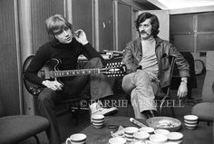 "Justin Hayward (Guitars) and Ray Thomas (Flute) of The Moody Blues circa 1970 in between takes from recording either ""A Question Of Balance"" (1970) of Every Good Boy Deserves Favour (1971)"