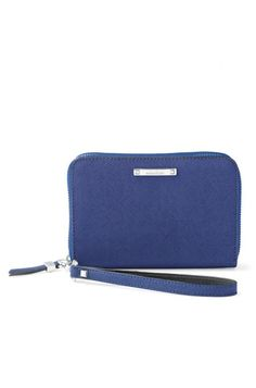 Find effortless organization with a cobalt blue zippered tech case by Stella & Dot. This compact blue zippered wallet clutch fits your phone, cash & cards.