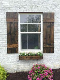 Shutters Custom Shutters Board and batten shutter cedar farmhouse shutters wood shutters rustic shutters exterior shutters stained shutters Exterior Design, Exterior Paint, Rustic Shutters, Brick Exterior House, Exterior Makeover, House Shutters, Rustic Exterior, Exterior Brick, House Exterior