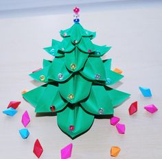 A personal favorite from my Etsy shop https://www.etsy.com/listing/245803476/origami-christmas-tree-paper-christmas