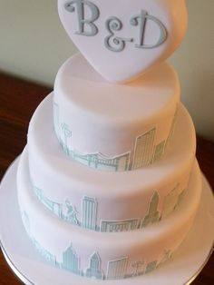 New York themed wedding cake with heart shaped topper.