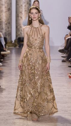 A dramatic theme with sweeping, floor-length jewel-encrusted gowns.