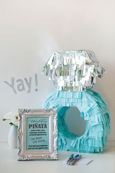 DIY wedding ring pinata as a guest book alternative.