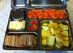 (from PlanetBox's facebook page)  ❀  mango  ❀  carrot curls  ❀  sliced chedder cheese  ❀  guacamole (in little dipper)