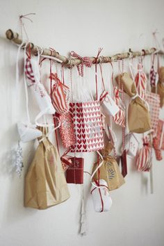 DIY Advent Calendar Ideas = it's all about the wrapping; can't go wrong with traditional red & white + brown paper!