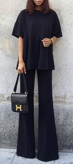 Simply wonderful. Clean flowing lines and unbroken seams lend to the chic flavor of this outfit. There's nothing plain about this look when the proportions are on point.