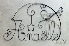 """is a French feminine variant of Anael is a modernized form of either Hannah or Anne/Anna (Anne itself being a version of Hannah). The meaning is """"grace. Sculptures Sur Fil, Barbed Wire Art, Stylo 3d, Wire Name, Cloud Craft, Name Wall Art, Wire Flowers, Wire Weaving, Wire Crafts"""