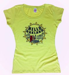 """""""Hello Oakland Tee.""""  Women's graphic tee. Celebrate the City of Oakland when you wear this exclusive prickly pear tee with some of Oakland's notable landmarks & sport names."""