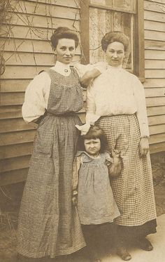 Free vintage images #vintage, two ladies and a little girl, all wearing checked aprons