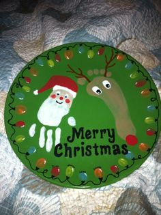 8448a5de887 Christmas Plate - painted at the Art Cafe . Joseph s foot  amp  Lane s hand