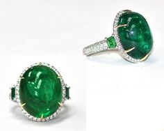 This custom ring contains a 21.87 carat cabachon emerald center with trapezoid emeralds and diamond accents.