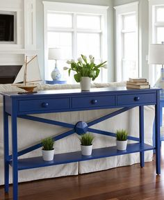 Console sofa table with starfish medallion from Maine Cottage