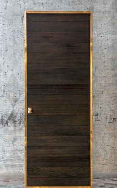 The Shou Sugi Ban door is a Japanese-style door with a brass border.