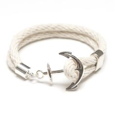 Our anchor bracelet is essential for any nautical lover! -Natural ivory cotton rope -Silver plated anchor clasp -Silver plated spacer bead *************************************************************