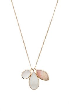 Putting a twist on a classic charm favorite, this **Melissa Joy Manning** necklace embodies the beautifully organic feel of the brand while still maintaining the luxurious quality of an heirloom.
