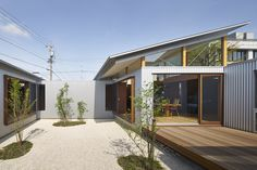 Arii Arie Architects uses angled windows to create tilted roofs for Japanese house extension