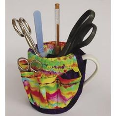 Not using that coffee mug anymore? Turn it into a useful storage place for pens, pencils, small scissors, notepad, etc.