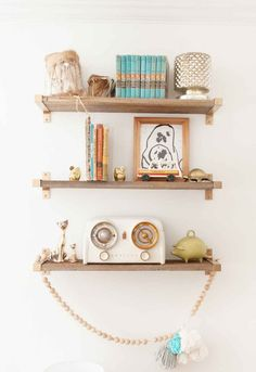 Use reclaimed wood and IKEA shelf brackets to add storage space to your walls.