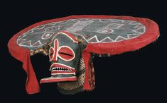 "Africa | ""Chihongo"" mask from the Chokwe people of Angola | Paint, resin, fabric, wood and rope || Copyright : Archives Musée Dapper, Paris et Museu Antropologico, Museu de Historia Natural da Universidade de Coimbra - Photo O. Gallaud"
