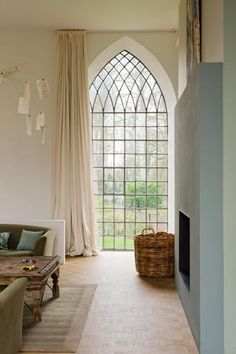 Awesome windows in a home converted from a chapel. Incredible statement idea