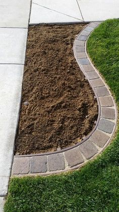 Create a flower bed edging that is a mow strip so you can cut ALL of the grass.
