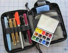 """New """"perfect"""" bag for my sketching tools, Maxpedition EDC Pocket Organiser I discovered here www.flickr.com/photos/yusincolorado/5559361128/in/pool-da... With large Pentel Aquash waterbrush, Pentel Mechanical Pencil 0.5 HB, Escoda 1214 travel brushes No.10 and 6, Pilot Parallel Pen 1.5 mm with J. Herbin Rouge Caroubier ink, Sailor Sapporo EF nib with Platinum Carbon Ink, Lamy Al-Star EF nib with Platinum Carbon Ink, Winsor and Newton Bijou Box.  Left pocket holds hand made journal 14x10…"""