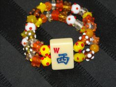 Mahjong bracelet with bumpy beads by Earmarksdesigns on Etsy, $20.00