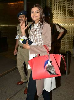 sonam kapoor leaving for cannes wearing houndstooth jacket with black jeans , a fendi bag with karlito on it