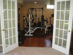 finished basement with separate exercise room | Sigovich Design & Build Interiors - Finished Basement Photos