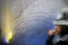 Through a Glass Darkly by Nick Turpin l #London #commuters #streetart