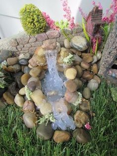 I recently ran across a picture of a fairy garden waterfall that was made by using a hot glue gun. Since I love creating fairy gardens of my own, I wanted to ad… #ILoveMyGarden